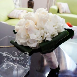 Fresh cream roses and hydrangea bridesmaid bouquet, with white satin wrap (side-view) - Toronto Wedding Flowers Created by Secrets Floral Collection