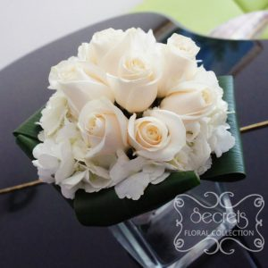 Fresh cream roses and hydrangea bridesmaid bouquet, with white satin wrap (top-view) - Toronto Wedding Flowers Created by Secrets Floral Collection