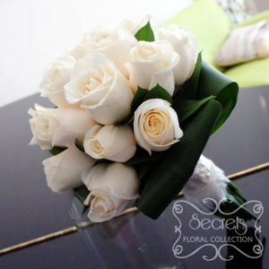 Fresh cream roses with aspidistra leaves toss bouquet - Toronto Wedding Flowers Created by Secrets Floral Collection