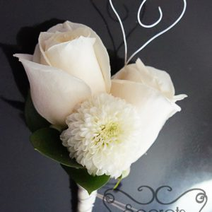 Fresh double-bloom cream roses and white ice cap mum boutonniere, with silver wrapping with silver-wire heart - Toronto Wedding Flowers Created by Secrets Floral Collection