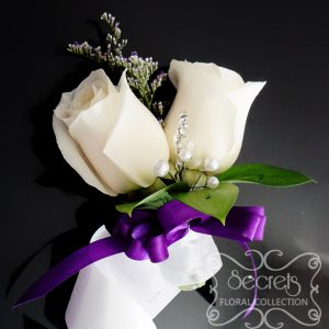 Fresh double-bloom cream roses and purple limonium wristlet corsage, with purple bow and jewel embellishments (front-view) - Toronto Wedding Flowers Created by Secrets Floral Collection