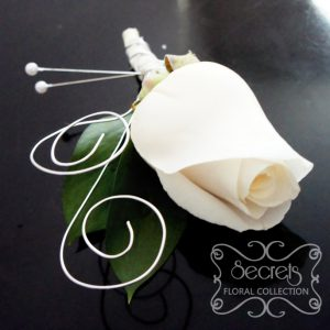 Fresh cream rose boutonniere with silver wrapping and silver-wire curls (top-view) - Toronto Wedding Flowers Created by Secrets Floral Collection