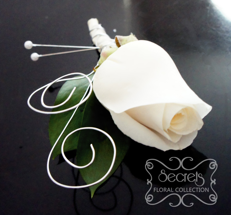 Fresh Cream Rose Boutonniere With Silver Wrapping And Silver Wire Curls Top View