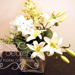 Artificial White Lilies, White Hydrangea, and Pale Green Lilac in Square Vase