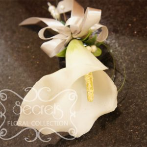 Artificial White Calla Lily and Snowberries Wristlet with Dangling Pearls (Top View) - Toronto Wedding Flowers Created by Secrets Floral Collection