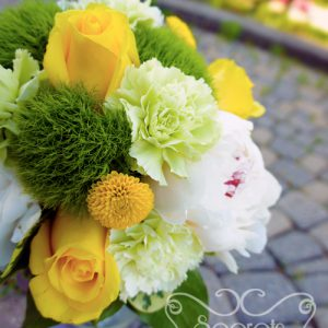 Fresh white peonies, yellow roses, green trick dianthus, and yellow button mums toss bouquet, with silver ribbon wrap (close-up) - Toronto Wedding Flowers Created by Secrets Floral Collection