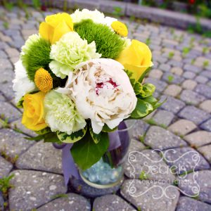 Fresh white peonies, yellow roses, green trick dianthus, light green carnations, and yellow button mums toss bouquet, with silver ribbon wrap (side-view) - Toronto Wedding Flowers Created by Secrets Floral Collection