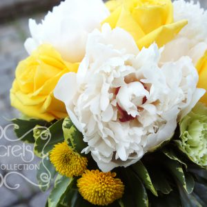 Fresh white peonies, yellow roses, light green carnations, and yellow button mums bridesmaid bouquet (close-up) - Toronto Wedding Flowers Created by Secrets Floral Collection