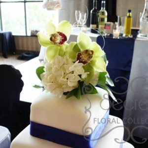 Green Cymbidium Orchids and White Hydrangea Cake Topper (on Cake)