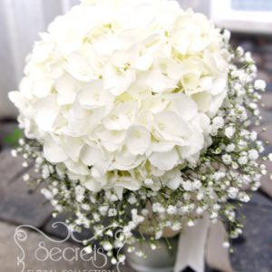 Fresh cream hydrangea and baby's breath bridesmaid bouquet, with ivory satin wrap - Toronto Wedding Flowers Created by Secrets Floral Collection