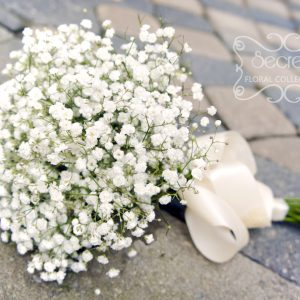 Fresh baby's breath bridesmaid bouquet, with ivory satin wrap - Toronto Wedding Flowers Created by Secrets Floral Collection