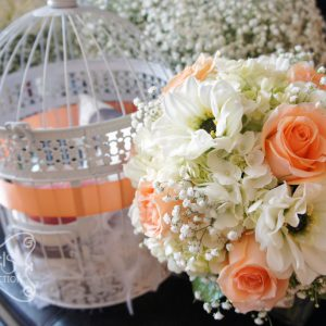 Fresh peach roses, white dahlia, cream hydrangea, and baby's breath bridal bouquet, with ivory multi-loops wrap, black jewel, and sentimental photo frames (top-view) - Toronto Wedding Flowers by Secrets Floral Collection