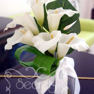 Artificial white calla lilies bridesmaid bouquet, with monstera and aspidistra leafs and tied in white satin bow - Toronto Wedding Flowers Created by Secrets Floral Collection