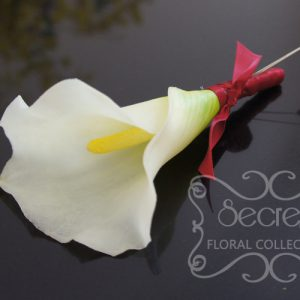 Artificial (soft-touch) white calla lily boutonniere, with wine red satin wrap and double pearl pins - Toronto Wedding Flowers Created by Secrets Floral Collection