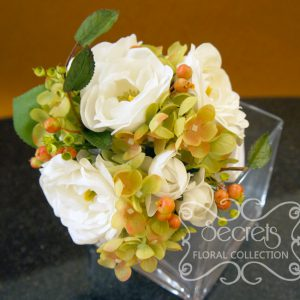 Artificial (real-touch) white ranunculus, green hydrangea, red privet berries, and eucalyptus toss bouquet (Top View) - Toronto Wedding Flowers Created by Secrets Floral Collection
