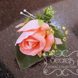 Artificial coral pink rose and and eucalyptus boutonniere (Top View) - Toronto Wedding Flowers Created by Secrets Floral Collection