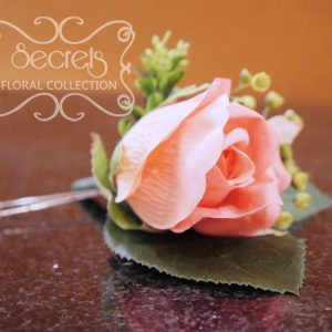 Artificial coral pink rose and and eucalyptus boutonniere (Side View) - Toronto Wedding Flowers Created by Secrets Floral Collection