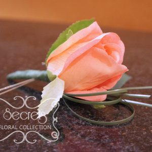 Artificial coral pink rose and and bear grass boutonniere (Side View) - Toronto Wedding Flowers Created by Secrets Floral Collection