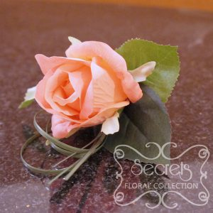 Artificial coral pink rose and and bear grass boutonniere (Top View) - Toronto Wedding Flowers Created by Secrets Floral Collection