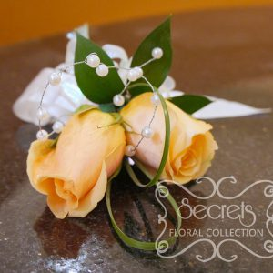 Fresh peach roses and bear grass wristlet with pearl embellishment (Top View) - Toronto Wedding Flowers Created by Secrets Floral Collection