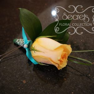 Fresh peach rose and bear grass boutonniere with tiffany blue ribbon and silver wire embellishments - Toronto Wedding Flowers Created by Secrets Floral Collection