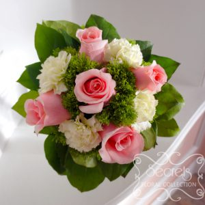 Fresh light pink roses, green carnations, and green trachelium bridesmaid bouquet, with silver satin and pearl wrap (Top View) - Toronto Wedding Flowers Created by Secrets Floral Collection