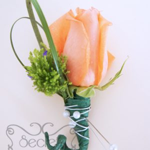 Fresh peach rose, green trachelium, and purple statice flowers pin-on corsage, embellished with pearls and green wrap (front-view) - Toronto Wedding Flowers Created by Secrets Floral Collection