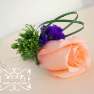 Fresh peach rose, green trachelium, and purple statice flowers boutonnière (top-view) - Toronto Wedding Flowers Created by Secrets Floral Collection