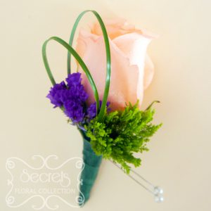 Fresh peach rose, green trachelium, and purple statice flowers boutonnière (front-view) - Toronto Wedding Flowers Created by Secrets Floral Collection