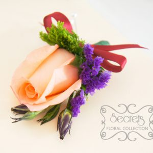 Fresh peach rose, purple lisianthus green trachelium, and purple statice flowers pin-on corsage, embellished with burgundy ribbon (top-view) - Toronto Wedding Flowers Created by Secrets Floral Collection