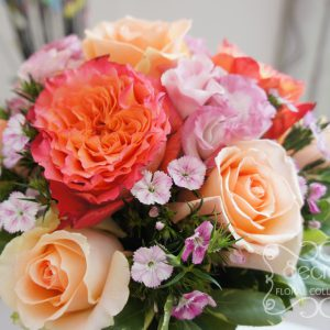 Fresh two-tone peach garden roses (free spirit), peach standard roses, bi-colour pink lisianthus, and light pink sweet william bridesmaid bouquet, with salmon pink wrap (close-up) - Toronto Wedding Flowers Created by Secrets Floral Collection