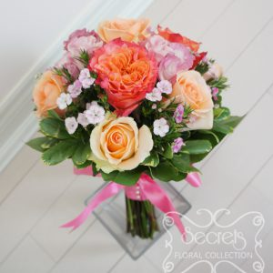 Fresh two-tone peach garden roses (free spirit), peach standard roses, bi-colour pink lisianthus, and light pink sweet william bridesmaid bouquet, with salmon pink wrap (front-view) - Toronto Wedding Flowers Created by Secrets Floral Collection