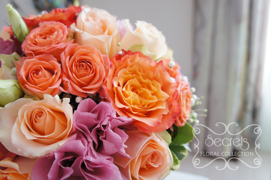 fresh two tone peach garden roses free spirit peach standard and spray roses solid pink and bi colour pink lisianthus and babys breath bridal bouquet