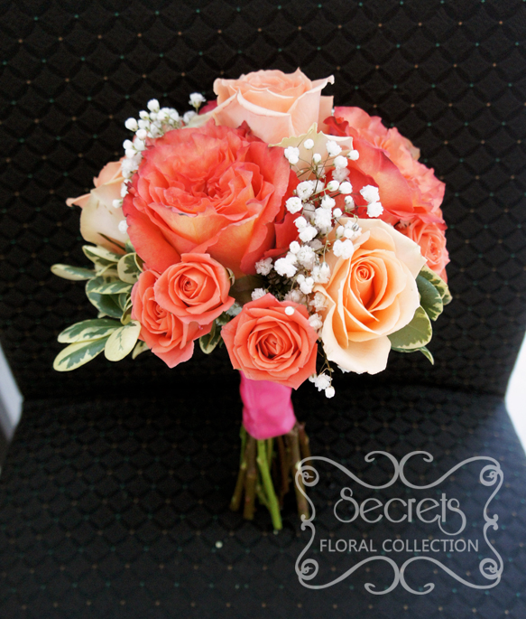 fresh two tone peach garden roses free spirit peach standard roses and spray roses and babys breath toss bouquet with salmon pink wrap