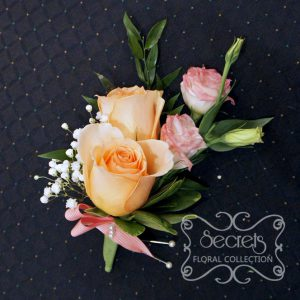 Fresh double-bloom peach roses, pink bi-colour lisisanthus, and baby's breath boutonniere, embellished with coral and white stripe-pattern ribbon (front-view) - Toronto Wedding Flowers Created by Secrets Floral Collection