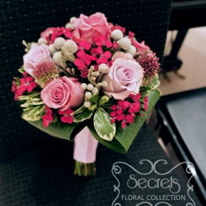 Fresh lavender roses, purple bullet allium, silver brunia berries, and fuchsia sweet william bridesmaid bouquet (top view) - Toronto Wedding Flowers Created by Secrets Floral Collection