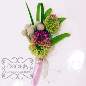 Fresh purple bullet alliums, silver brunia berries, and lily grass boutonniere, with silver and lavender ribbon (front-view) - Toronto Wedding Flowers Created by Secrets Floral Collection