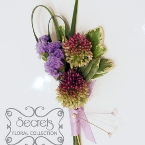 Fresh purple bullet alliums, lavender statice flowers, and lily grass boutonniere, with silver and lavender ribbon (front-view) - Toronto Wedding Flowers Created by Secrets Floral Collection