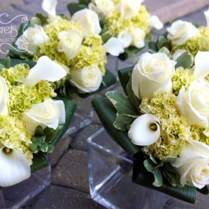 Fresh cream roses, white calla lilies, and baby green hydrangea bridesmaid bouquet, with royal purple satin wrap and crystal jewelry on it (top-view) - Toronto Wedding Flowers Created by Secrets Floral Collection