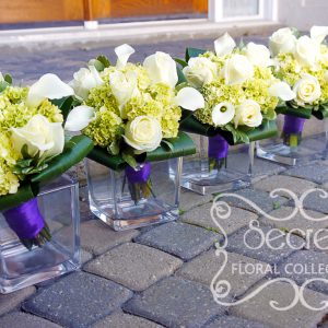 Fresh cream roses, white calla lilies, and baby green hydrangea bridesmaid bouquet, with royal purple satin wrap and crystal jewelry on it (side-view) - Toronto Wedding Flowers by Secrets Floral Collecton