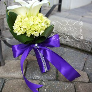 Fresh white calla lilies and baby green hydrangea junior bridesmaid bouquet, with royal purple satin wrap and crystal embellishments (front-view) - Toronto Wedding Flowers Created by Secrets Floral Collection