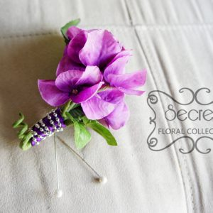 Artificial lavender hydrangea boutonniere with purple ribbon and silver beads wrap (front-view) - Toronto Wedding Flowers Created by Secrets Floral Collection
