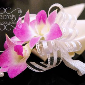 Fresh triple-bloom dendrobium orchids wristlet, with pearl embellishments and ivory wrap (side-view) - Toronto Wedding Flowers Created by Secrets Floral Collection