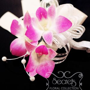 Fresh triple-bloom purple dendrobium orchids wristlet, with pearl embellishments and ivory wrap (top-view) - Toronto Wedding Flowers Created by Secrets Floral Collection