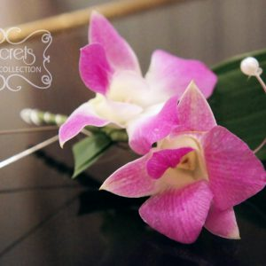 Fresh double-bloom purple dendrobium orchids boutonniere, with pearl embellishments and silver wire wrap (top-view) - Toronto Wedding Flowers Created by Secrets Floral Collection