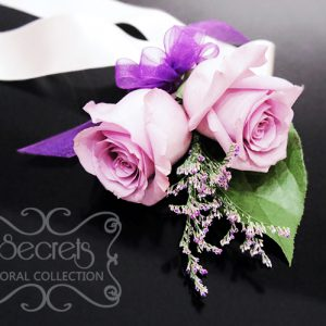 Fresh double-bloom lavender roses and misty blue limonium wristlet with purple organza bow - Toronto Wedding Flowers Created by Secrets Floral Collection