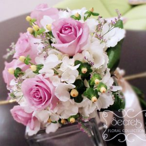 Fresh lavender roses, white hydrangea, ivory hypericum berries, and misty blue limonium toss bouquet with ivory satin wrap - Toronto Wedding Flowers Created by Secrets Floral Collection