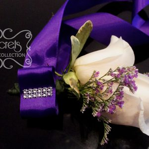 Fresh double-bloom cream roses and purple limonium wristlet, with large royal purple bow (front-view) - Toronto Wedding Flowers Created by Secrets Floral Collection