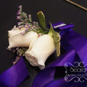Fresh double-bloom cream roses and purple limonium wristlet, with large royal purple bow (top-view) - Toronto Wedding Flowers Created by Secrets Floral Collection