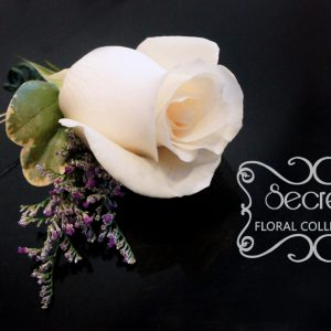 Fresh cream rose and purple lumonium boutonniere, embellished with crystallized bling ribbon (top-view) - Toronto Wedding Flowers Created by Secrets Floral Collection